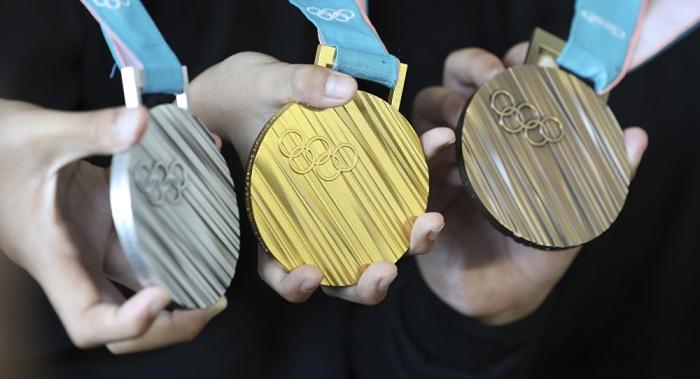 Кто распилил медали после Олимпийских игр?